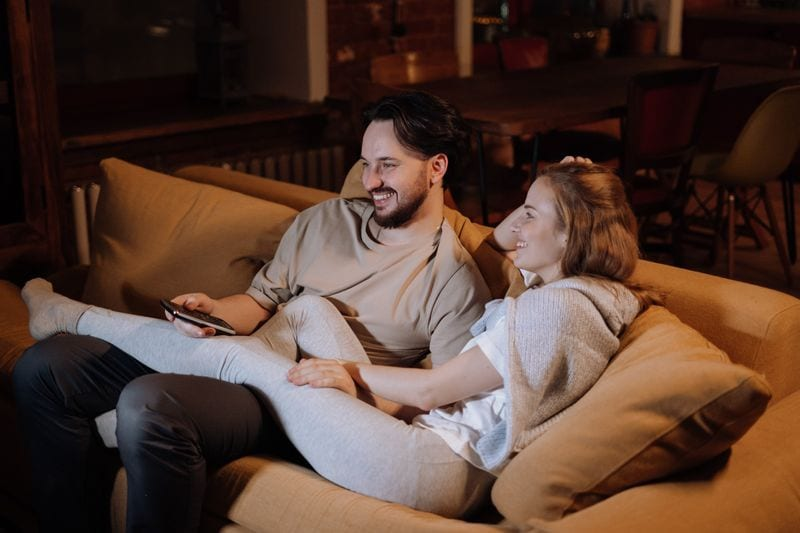 Man and Woman on couch grasshopper position