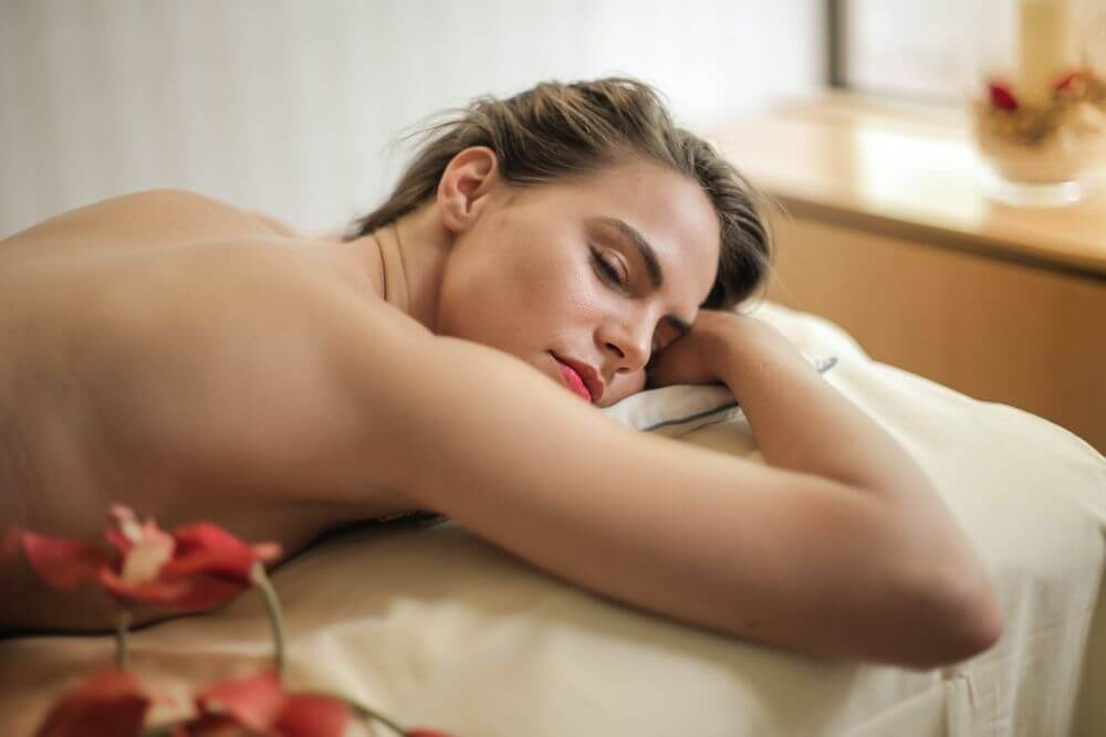 woman lying on bed in the SPA adult furniture