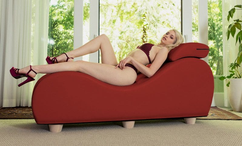 Blonde woman in dark lingerie on top of red Liberator Esse Chaise II