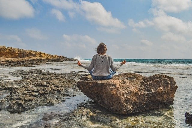 Girl meditation in nature