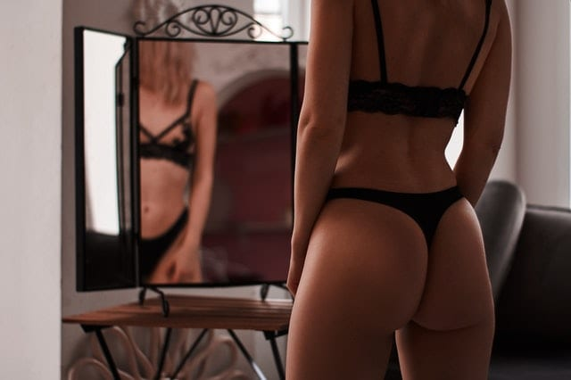 Naked woman in black lingerie