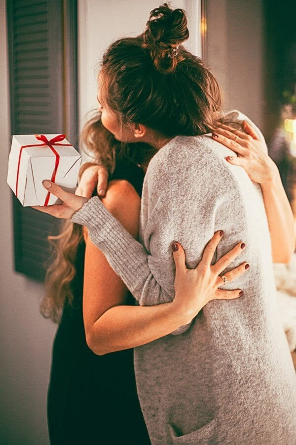 Girl giving a present to a girl