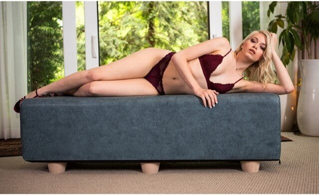 Blonde girl laying on Prelude Bench Queen Black Label