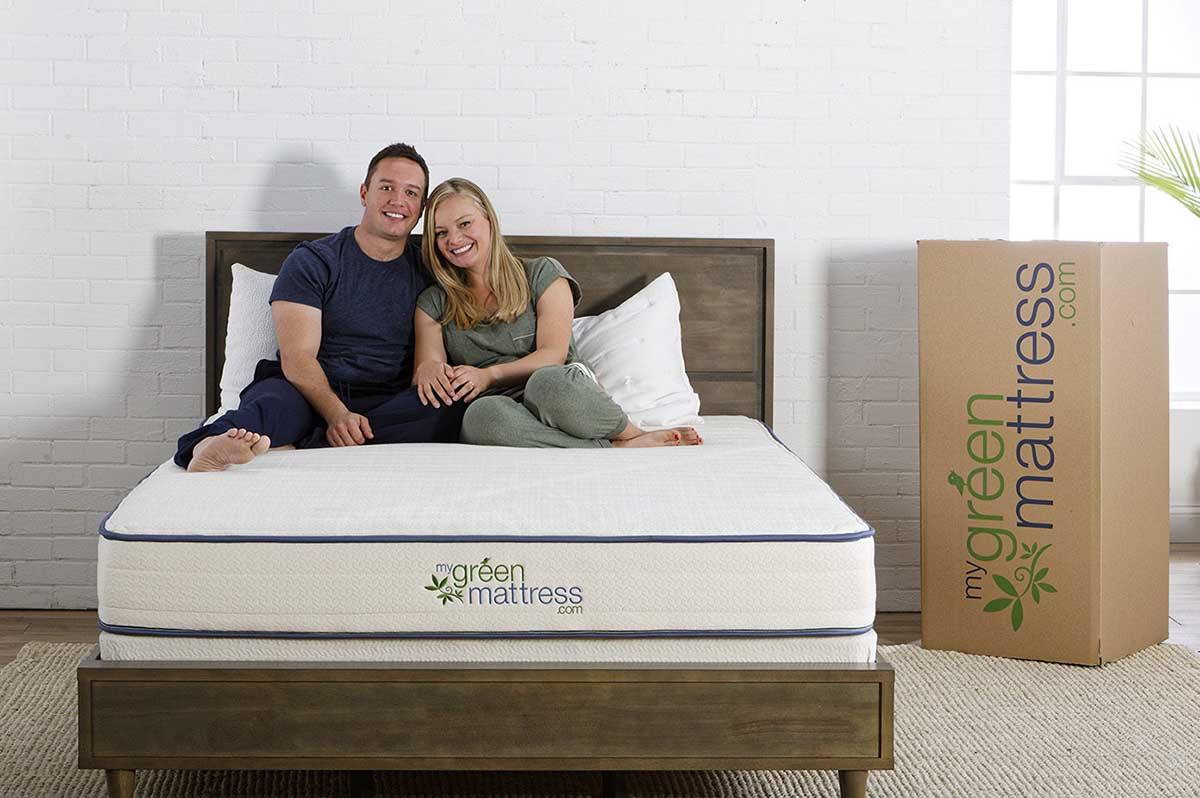 couple sitting on the Best Latex Mattress For Sex