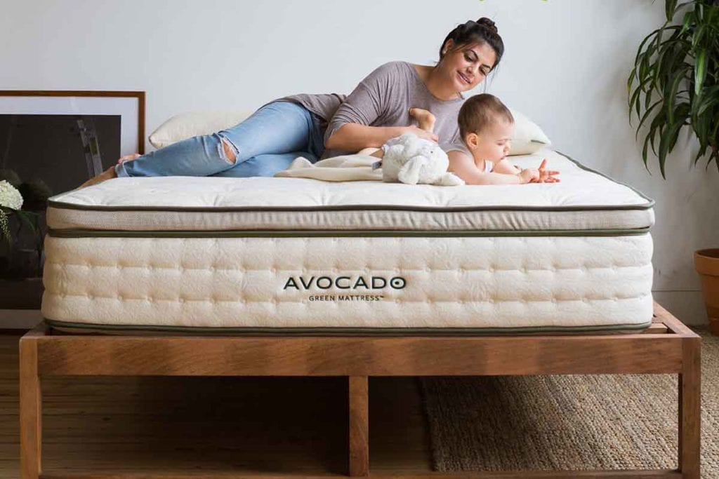 Mom with baby lying on the AVOCADO GREEN MATTRESS