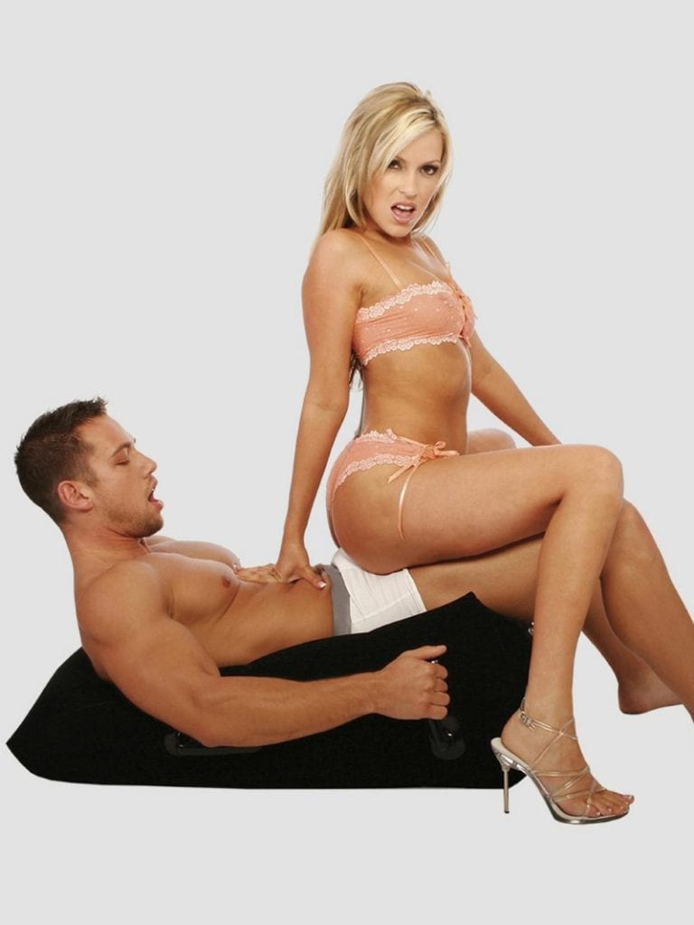couple on an inflatable wedge pillow