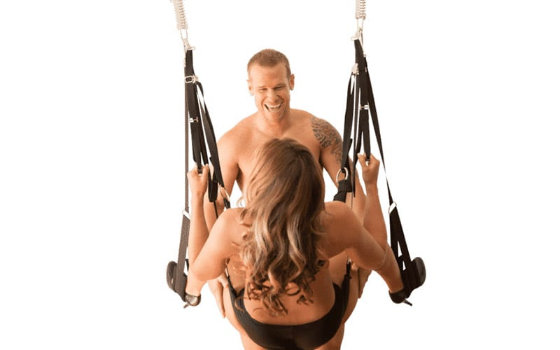Couple play on the Screamer Sex Swing Dual Hook