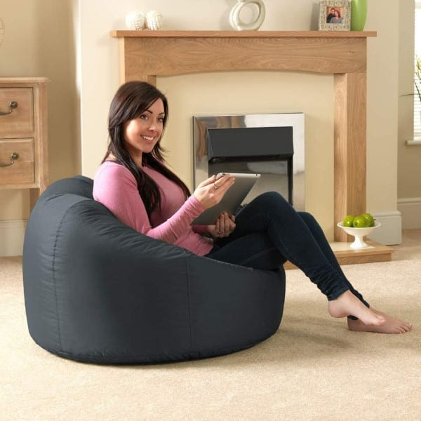 Girl in pink blouse sits on Bazaar Panelled Classic Bean Bag Chair