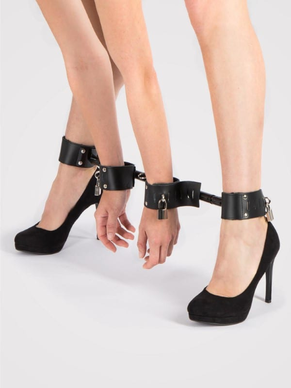 Woman cuffed in Bondage Boutique Extreme Expandable Spreader